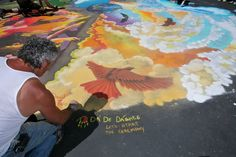 """David """"Two Hawk"""" Glazier working on the air element of the elemental circle at the Youth in Arts Italian Street Painting Festival San Rafael, California 2010"""