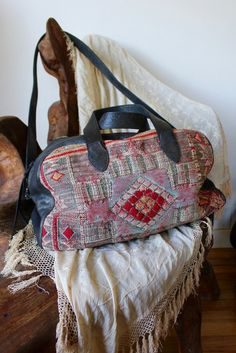 A Honeywood Original Bag. Now with a removable cross body strap! One of a kind and Super Versatile In New GunMetal Distressed Leather and Antique Textiles This bag has a handwoven Antique Textile Face
