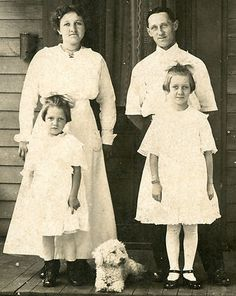 Vintage family portrait with a poodle