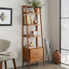 "22""w x 15""d x 70.25""h. Three fixed shelves. Bottom drawer is a lateral filing cabinet. Mid-Century Bookshelf - Narrow Tower 