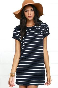 The Cafe Society Navy Blue Striped Shirt Dress is cool enough for the cafe crowd, and comfy enough for cuddling on the couch! Stretch knit shapes this casual t-shirt dress with a shift silhouette. Rounded neckline and short sleeves.