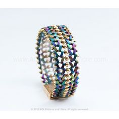 This V.O.V. Bracelet has a very slick and sophisticated look yet achieves a modern-world appearance. It is specially designed for anyone who likes to feel unique and free. Materials:  Precision Spacer Beads (PSB): 144 beads 4mm pearls or beads: 34 11/0 Toho beads 8/0 Toho beads Squareor Rectangular magnetic clasp: 1