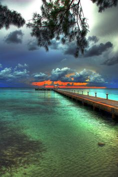 Sunset over the pier at Rum Point, Grand Cayman, by slack12.