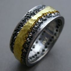 Todd Pownell: , Ring in 18k yellow gold, oxidized sterling silver, and 70 inverse set white diamonds. Measures 7mm wide. Size 5 (may be custom ordered in your size, allow 3-4 weeks)