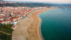 Nazare har verdens høyeste surfebølger - og en stor og deilig bystrand på den andre siden av et nes. Portugal, Beach, Water, Outdoor, Surfing, Lisbon, Gripe Water, Outdoors, The Beach