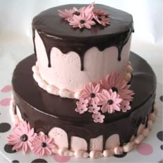 Pink Daisies and Ganache - Flowers done in fondant/gum paste mix, pink IMBC topped with dark chocolate ganache.