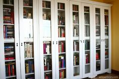 Now for the best part of all, the BOOKSHELVES! These are 4 separate shelves, each with glass doors to protect the books from dust. The 6-layer shelves are movable.  The two left units contain FICTION, while the two right ones NON-FICTION.  All-in-all these contain approximately 800 books.  Within FICTION and NON-FICTION are genre labels for my convenience. :-)