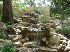 waterfall created for small back yard landscape