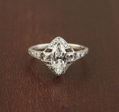 Stunning Art Deco Marquise Diamond Ring. Rare French cut side diamonds. Platinum.