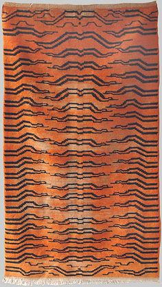 An early wool pile Tiger Rug, Tibetan  Circa 1880s  _ Esther Fitzgerald Rare Textiles