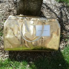 BCBG MaxAzaria Weekender Bag New with tags Bcbg maxazria Gold Overnight Weekender Bag  Appox Measurement 17 x 11 x 5 PRICE FIRM NO EXCEPTIONS BCBGMaxAzria Bags