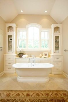 Another strategy: Place the tub next to a wall of built-ins that keep bath gear within easy reach. In this setting, the tub feels as much like furniture as the cabinetry does.