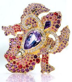 Orchid Brooch in 18k gold with kunzite and tsavorite Plus rubies, sapphires, and amethyst with diamond accents by Paula Crevoshay