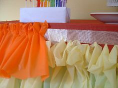 How to make a ruffled tablecloth out of plastic tablecloths...just what I've been looking for!