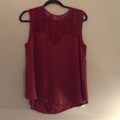 Burnt orange tank ASTR burnt orange tank with lace detailing! Worn a few times! Good condition! Polyester type material Tops Tank Tops