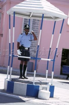 Bermuda policeman directing traffic in The Birdcage in Hamilton