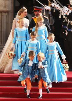 The bride's attendants were dressed in the traditional Nassau colours of blue and orange at the wedding of Luxembourg's Crown Prince Guillaume to Countess Stephanie de Lannoy.