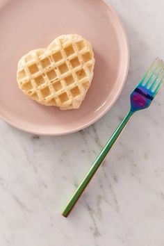Heart-Shaped Mini Waffle Maker Mini waffle maker with non-stick coating - perfect to have on hand for delicious, heart-shaped waffles at any time. Compact design so it's easy to store when not in use. Includes recipe guide to get you started. Modern Dinnerware, Dinnerware Sets, Mini Toaster, Urban Outfitters, Cute Valentines Day Gifts, Mini Fridge, Refrigerator, Heart Shapes, Cleaning Wipes