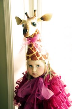 This baby's face looks disturbed probably because she has a freaking giraffe on her head...#toofar ---MM
