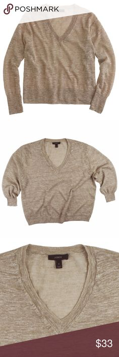 """JCREW Beige Marled Linen V-Neck Sweater Excellent condition! This Beige Marled Linen v-neck sweater from JCREW features a relaxed roomy fit, 3/4 length drop sleeves and is very lightweight - a semi sheer. Made of a linen blend. Measures: bust: 44"""", total length: 23"""", sleeves: 18"""" J. Crew Sweaters V-Necks"""