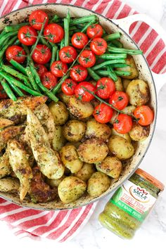 This pesto chicken bake is an easy, one pan, oven baked, family dinner. It's also dairy free and gluten free and packed with two portions of colourful vegetables.