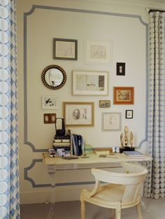"Love the molding. It creates a nice structure for ""randomly"" placed mirrors and art which is very chic!"