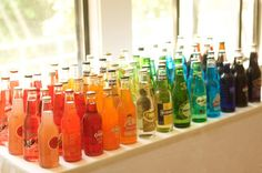 Brides: Old-fashioned Rainbow Soda Bar. An old fashioned soda bar will add some retro appeal to the cocktail hour spread—arrange the bottles by color and serve them with festive striped straws. Rainbow Drinks, Rainbow Theme, Rainbow Wedding, Rainbow Colors, Colorful Drinks, Rainbow Bar, Rainbow Glass, Rainbow Parties, Rainbow Food