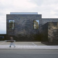 This simple shimmering black box hides a gallery inside.  Nicely done, Hat Projects.   Via, Dezeen