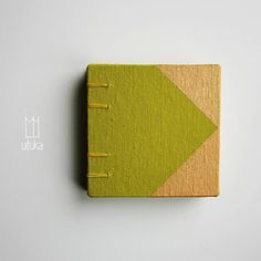 SHINY SQUARE #1  small coptic-stitch wedding favor / journal / sketchbook / notebook  spring green linen hardback covers, hand-painted with gold paint  beautifully textured yellow canson mi-teintes 160 gsm (98lb) paper inside covers yellow waxed thread 60 sheets (120 pages) of 100 gsm acid free unlined paper  covers: 9,5 cm x 9,5 cm ( 3.5 x 3.5 in)  inside pages: 9 cm x 9 cm ( 3.45 x 3.45 in)  thickness: 2 cm ( 0.8 in)  ♥ available for larger orders, just write us an email ♥…
