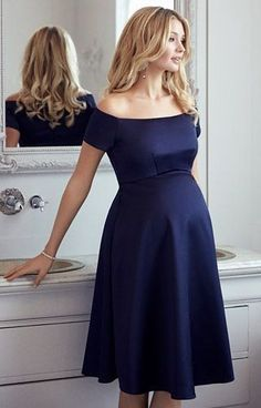 bd530a0dcef8 Channelling starlet beauty with a Bardot neckline that sits just off the  shoulder ...