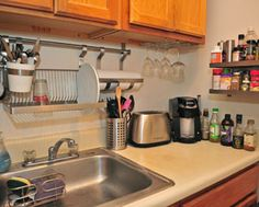 I'd like a hanging dish rack over the sink, not cabinets, and maybe some fun image/art above that