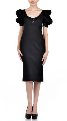 Cambria midi dress, conical with wide-neckline closed with five buttons and puffed sleeves.   Composition: 100»c.
