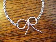 Pink Metalwork bow charm necklace-Breast Cancer awareness jewelry. $14.00, via Etsy.