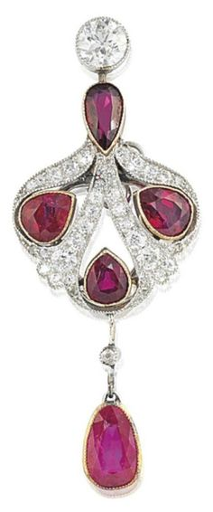 AN EDWARDIAN RUBY AND DIAMOND BROOCH, CIRCA 1905. Millegrain-set throughout, the brilliant-cut diamond top and pear shaped ruby surmount, suspending a pierced cartouche shaped panel with three further pear shaped ruby accents within an old-cut diamond border, to a ruby drop pendant, and knife edged bar connection, mounted in platinum and gold, circa 1905, 5.5cm.