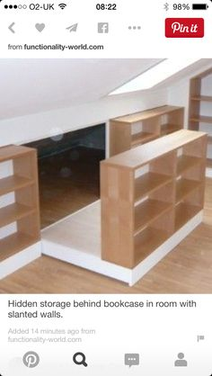 Bookshelf slides out to reveal more storage tucked into the slanted roof area. Dachausbau als Wohnraum ?fele Functionality World Attic Bedroom Storage, Attic Bedroom Designs, Loft Storage, Attic Bedrooms, Attic Design, Bedroom Loft, Attic Renovation, Attic Remodel, Loft Room