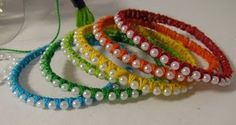 "pretty bracelets - plastic bottle  string of cheap ""pearls"" found at any craft/fabric store  Embroidery thread (I used the thick, 1 strand crewel thread)  scissors  tape"