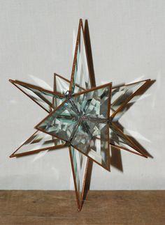 "Vintage 3D 12 Point Crystal Clear Prism 10"" Moravian Star. $22.00, via Etsy."