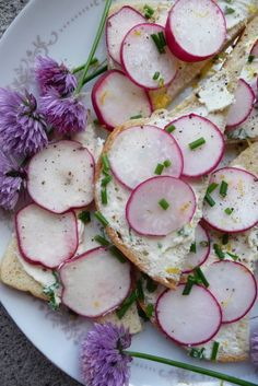 Lovely little open-faced fresh radish sandwiches on French bread or sourdough, with cream cheese and herbs. Slightly adapted from Rose Tea Cottage.