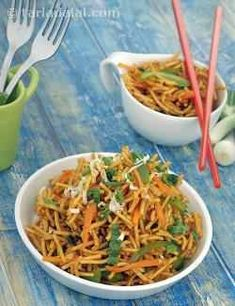Chinese Bhel is made with fried noodles, tossed with colourful sautéed veggies and garnished with crunchy spring onions. A generous dose of sauces is also added to bind the Bhel together in a tangy way! Chinese Bhel, Chinese Food, Chinese Vegetables, Mixed Vegetables, Veggies, Indian Snacks, Indian Food Recipes, Ethnic Recipes, Indian Appetizers