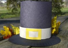 Pilgrim Hat Craft with a paper plate...it seems like this would fit better than just construction paper.