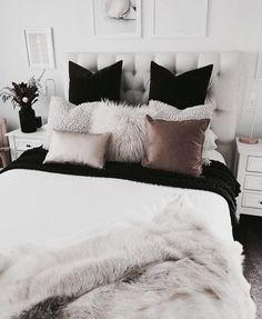 everything about this bed. color, pillows, fur. LOVE.