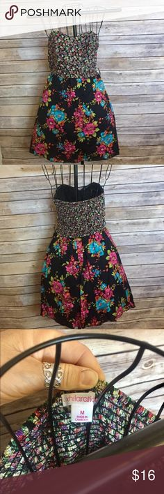 Black floral print strapless dress Cute black floral print strapless dress , lined , is missing belt but can be with various different belts Xhilaration Dresses