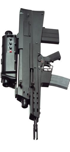 HK XM29 OICW. 25mm air burst grenade launcher with a 5.56 carbine... GIMME GIMME GIMME!!!