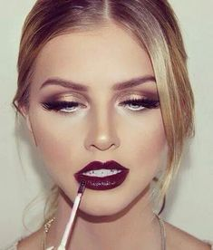 White, Black and Gold Wedding Make up. Such fab lips, a dramatic look for a winter wedding