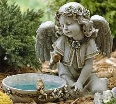 Features:  -Angel seated with solar powered birdbath figurine.  -Resin and stone mix construction.  Style: -Solar.  Primary Material: -Stone.  Color: -Gray. Dimensions:  Overall Height - Top to Bottom