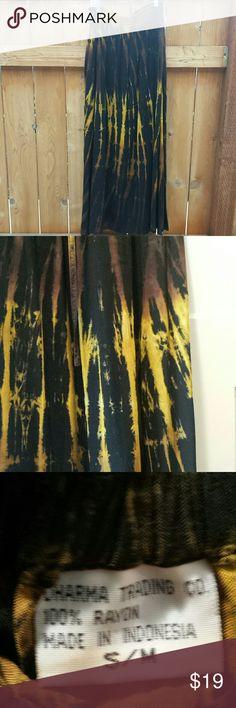 """Tie-Die maxi skirt S/M Dharma trading company.   Rich vibrant yellow black and brown.  Elastic waistband.   39.5"""" long;  13"""" across waistline,  ( elastic waistline ); 2 front pockets.   Excellent condition! Dharma trading company  Skirts Maxi"""