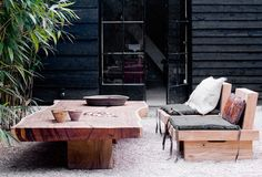 Loving the bamboo against the black, not to mention the gorgeous furniture.
