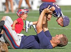 Tom Brady hangs out with his children after the New England Patriots football training camp.