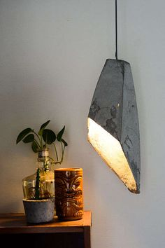 DIY Concrete Illuminators beautiful hanging pendant light in concrete with gold interior