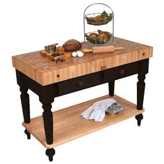 The 48 inch wide Cucina Kitchen Work Table by John Boos with shelf features hard maple butcher block tops with oil finish on legs, face, sides, and bottom. The work table comes with dovetailed maple drawers.